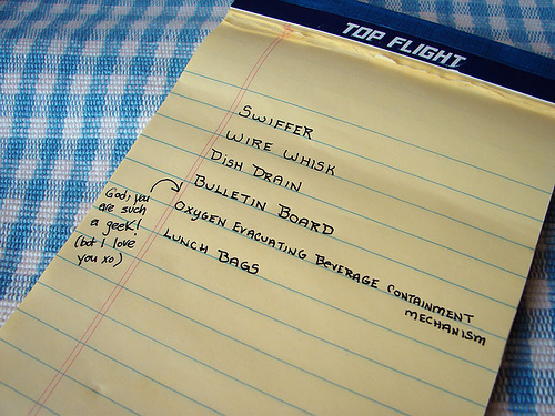 Grocery list written on a yellow legal pad