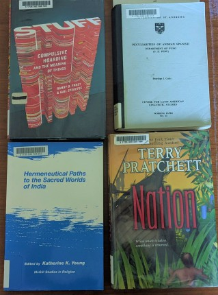 Four books: two are popular reading titles, two are more obscure scholarly titles.
