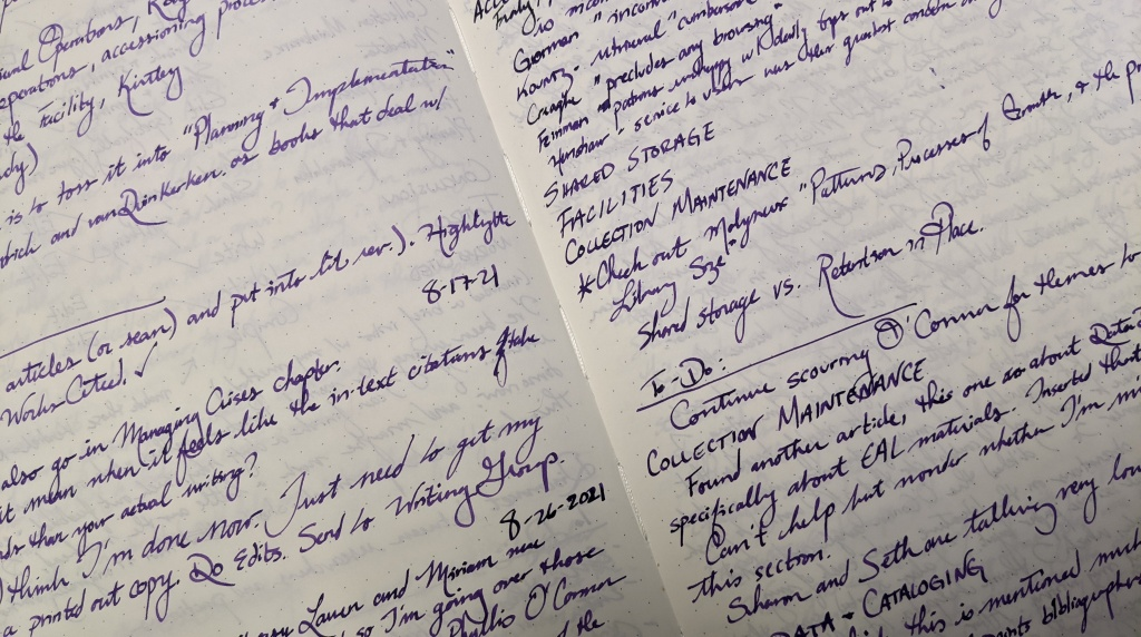 Photo of notebook with handwritten notes